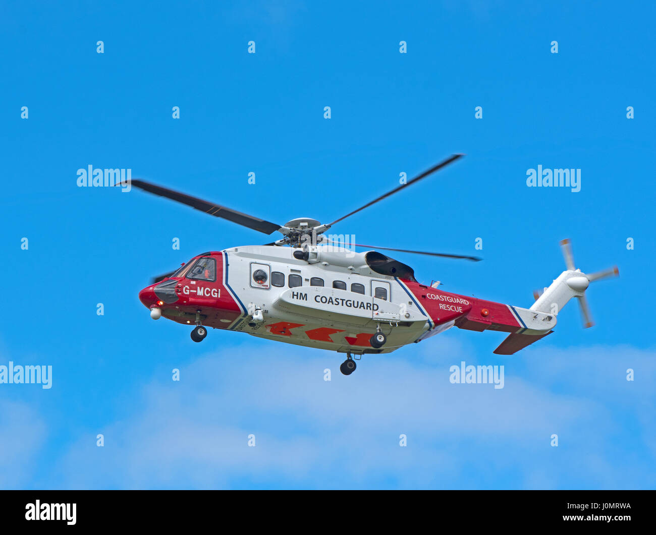 UK Coastguard Sikorsky S-92a Helicopter G-MCGI departing its Inverness Dalcross Airport base on an emergency callout. - Stock Image