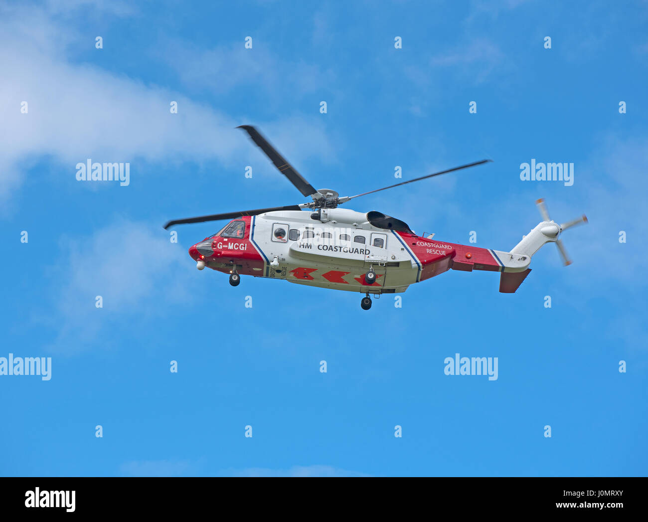UK Coastguard Sikorsky S-92a Helicopter G-MCGI departing its Inverness Dalcross Airport base on an emergency callout. Stock Photo