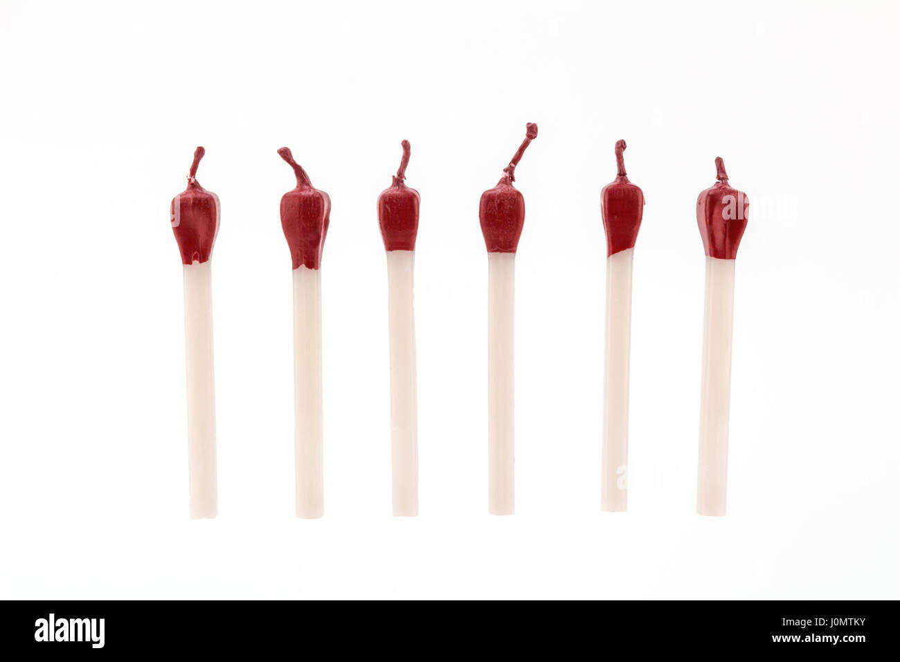 Birthday candles isolated on white - fun match stick shapes - Stock Image