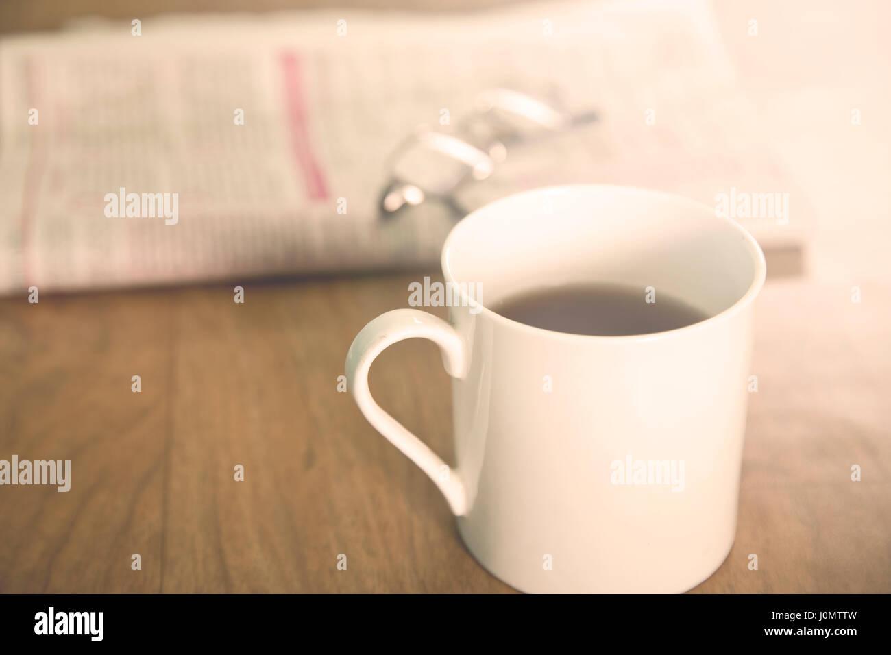 Tea over newspaper Stock Photo
