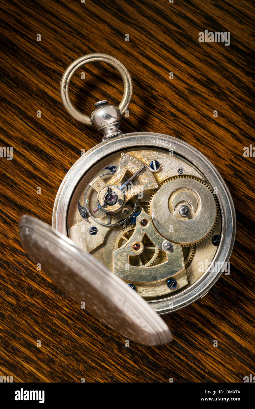 Detail of precise mechanism in antique Ami Sandoz & Fils Swiss hand carved Duplex Escapement style silver pocket - Stock Image