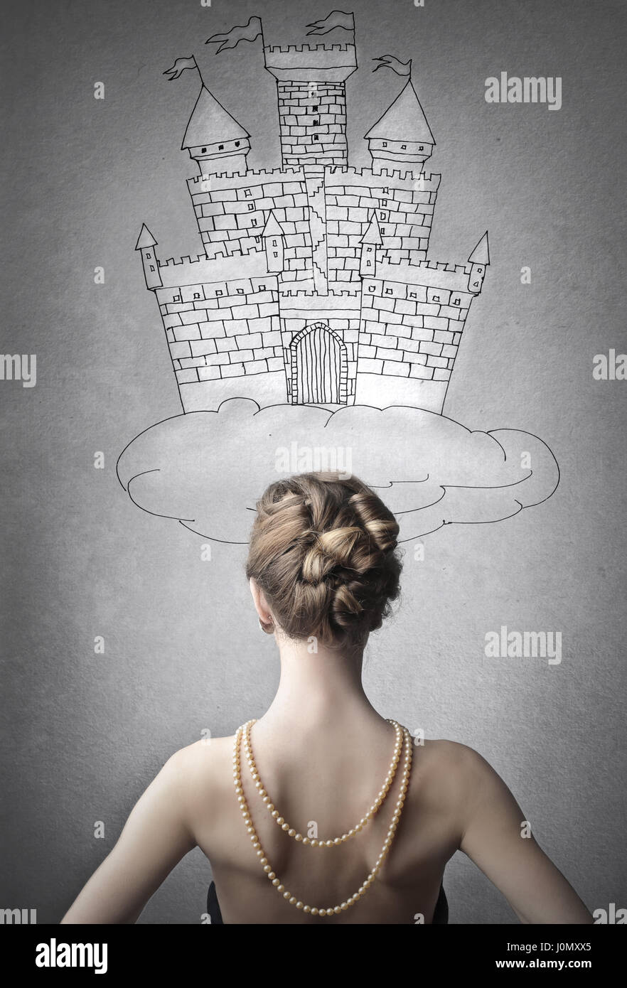 Woman in front of drawn castle - Stock Image