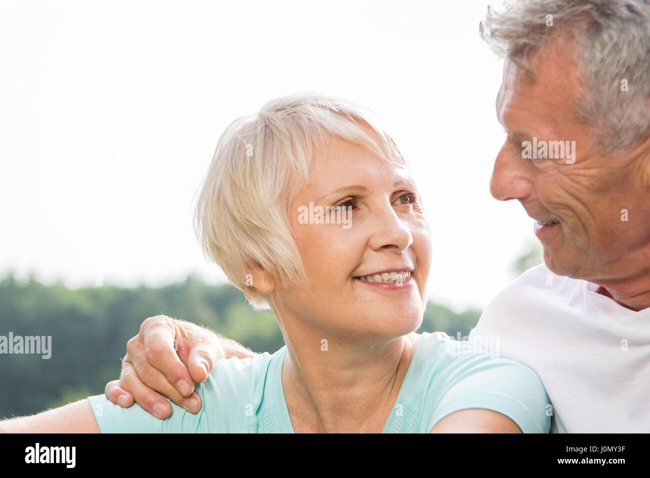 MODEL RELEASED. Senior couple smiling, man with arm around woman. Stock Photo