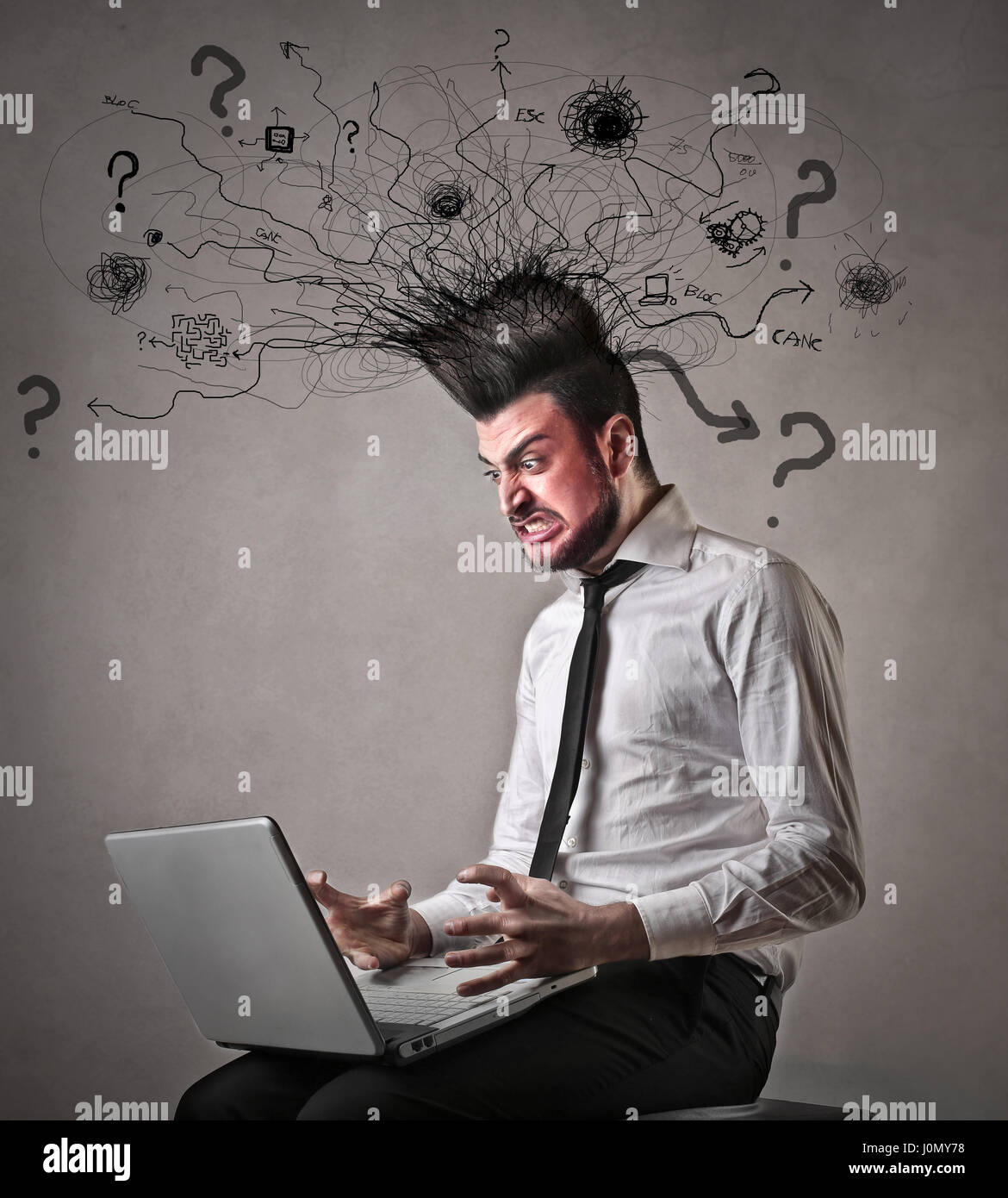 Man being mad in front of laptop - Stock Image