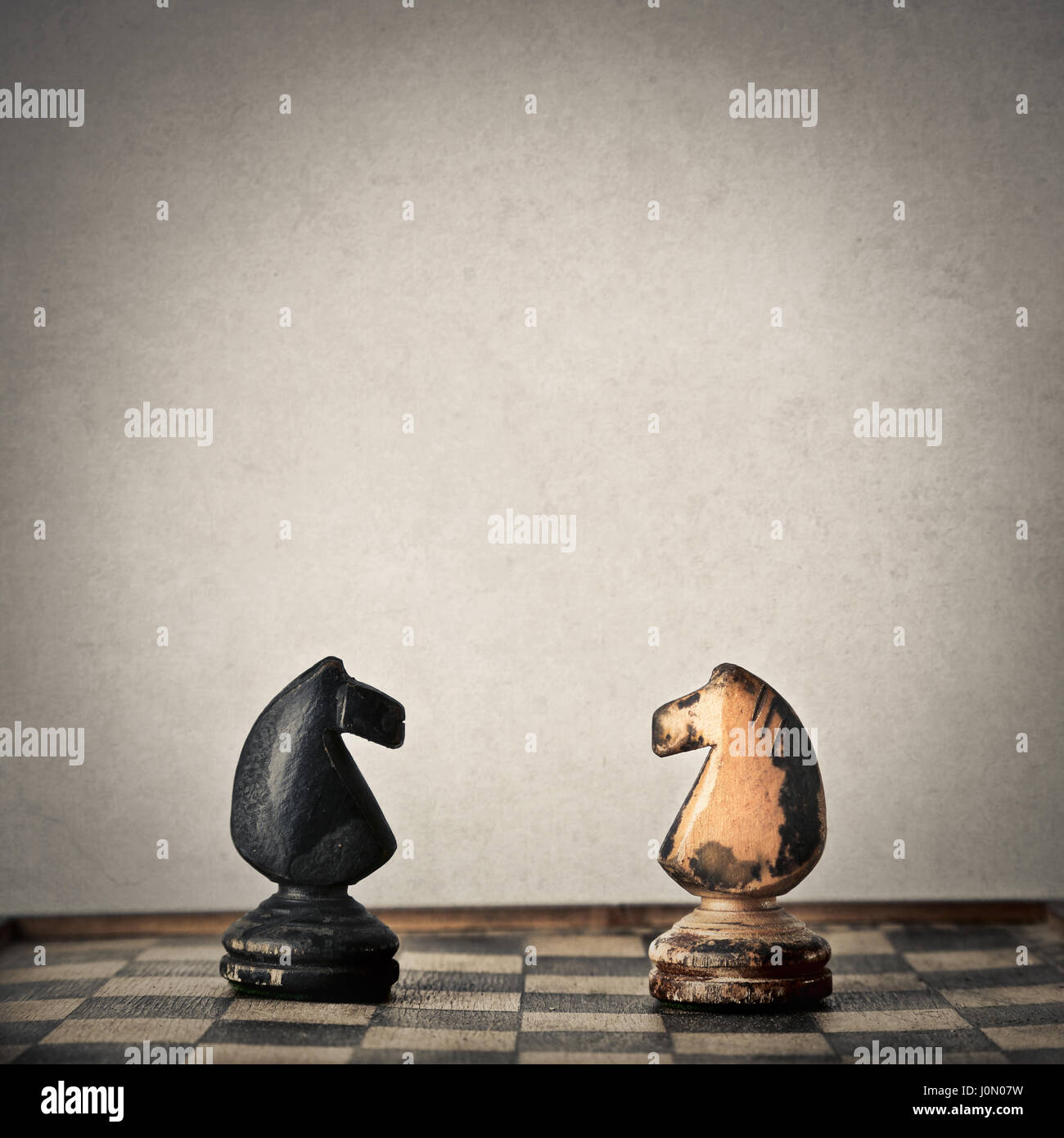Two chess horses facing each other - Stock Image