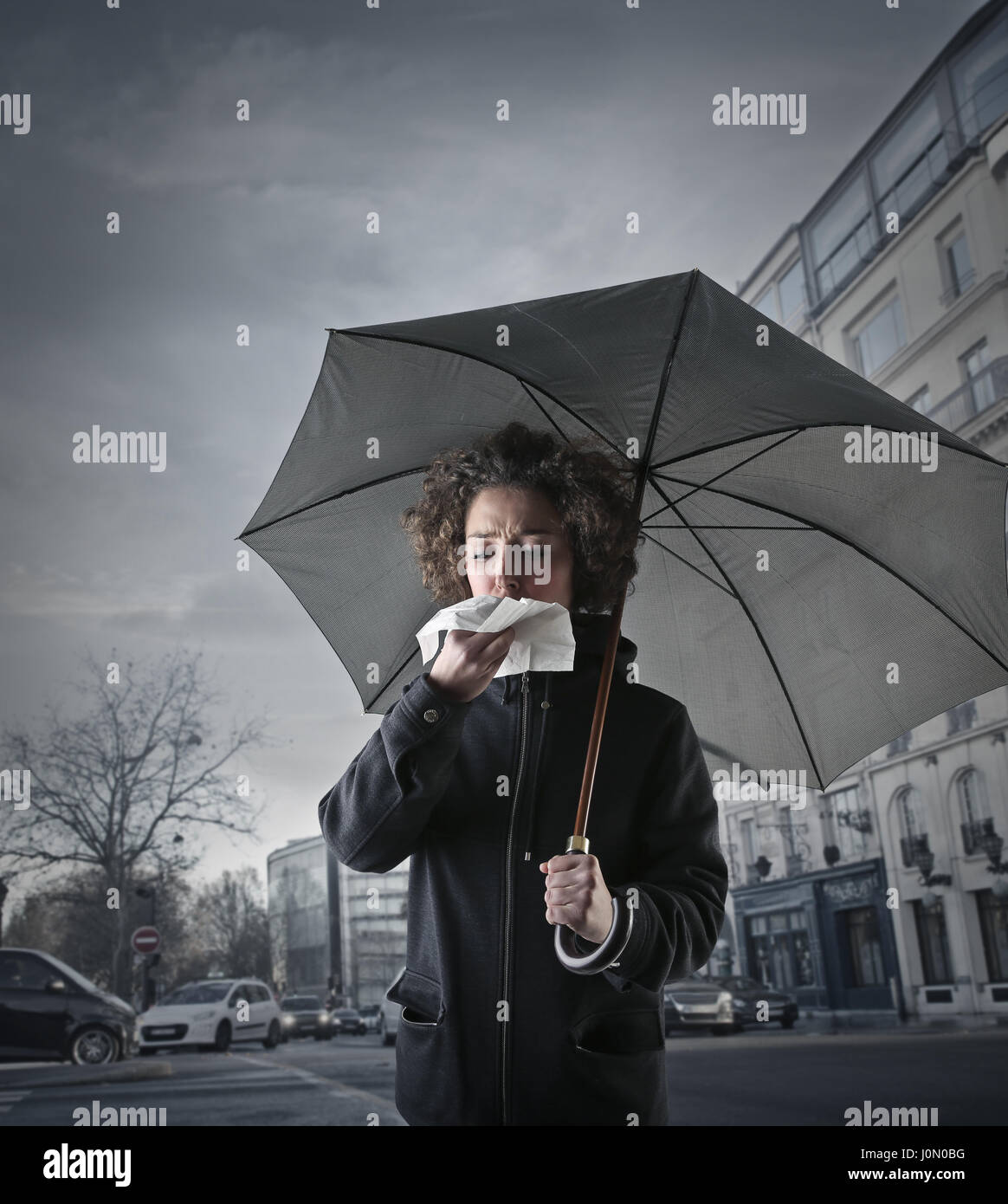 Sick woman with umbrella - Stock Image