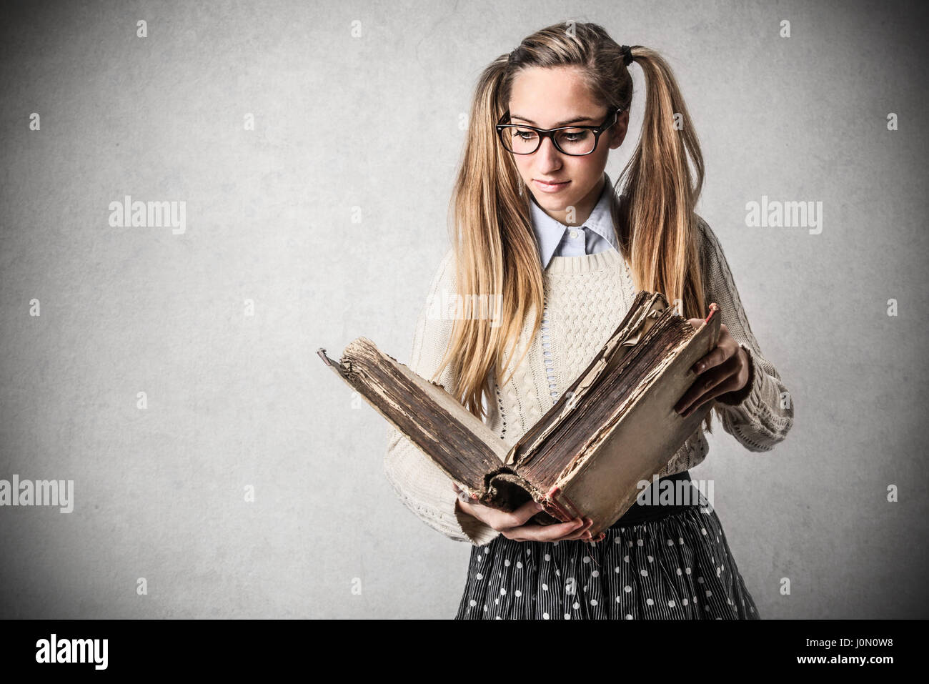 Young woman studying from book - Stock Image