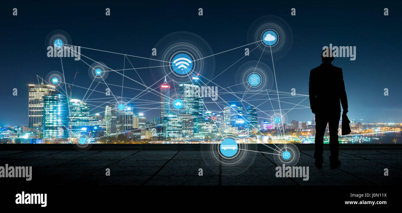 The silhouette businessman with city and wireless communication network background, abstract image visual, internet Stock Photo