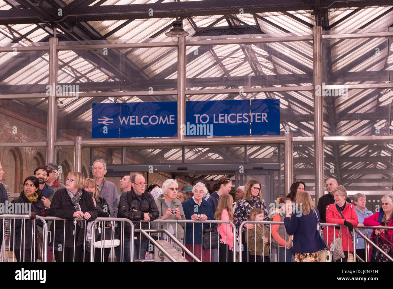 Leicester, UK. Thursday 13th April 2017.crowds wait to welcome Her Majesty Queen Elizabeth II and The Duke or Edinburgh - Stock Image