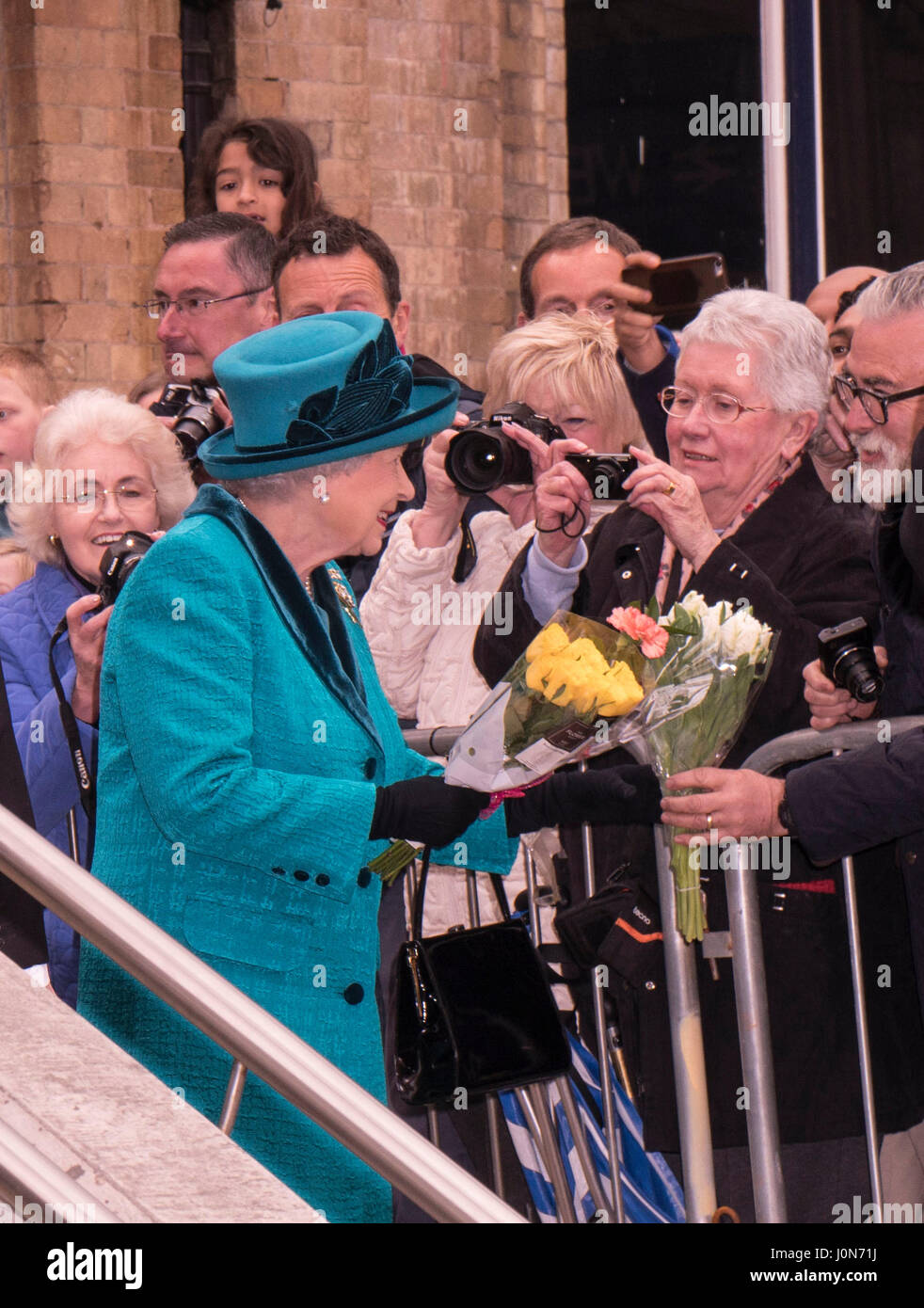 Leicester, UK. Thursday 13th April 2017. Her Majesty Queen Elizabeth II is presented with flowers as she and The Stock Photo