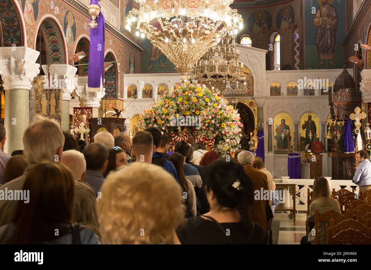 Larissa, Greece. 14th Apr, 2017. Holy Week in Greece: People on a line waiting to kiss the figure of Christ inside - Stock Image