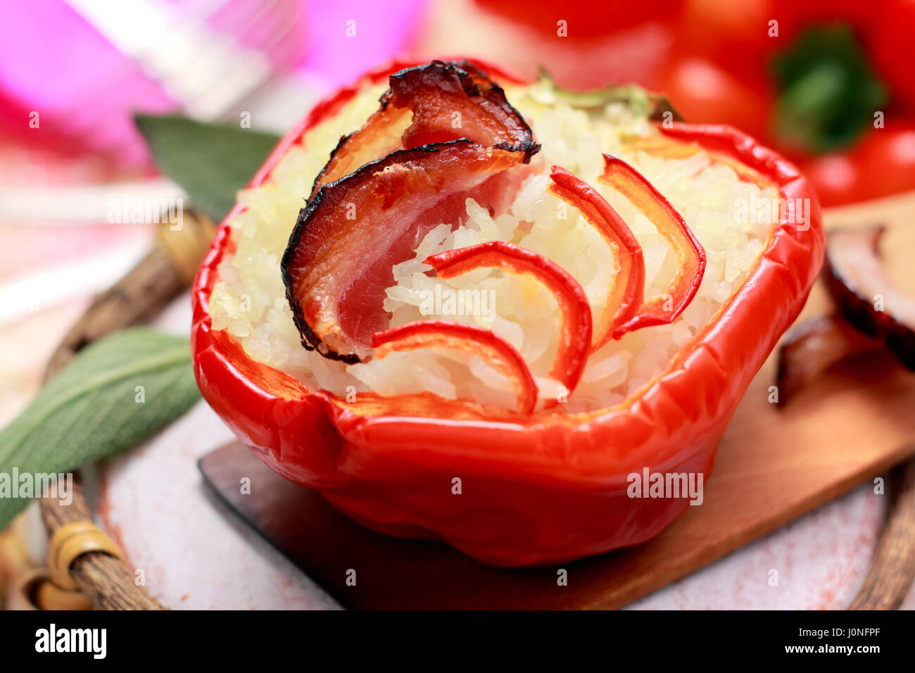 Roasted red pepper stuffed with rice and bacon. Very low depth of field. - Stock Image
