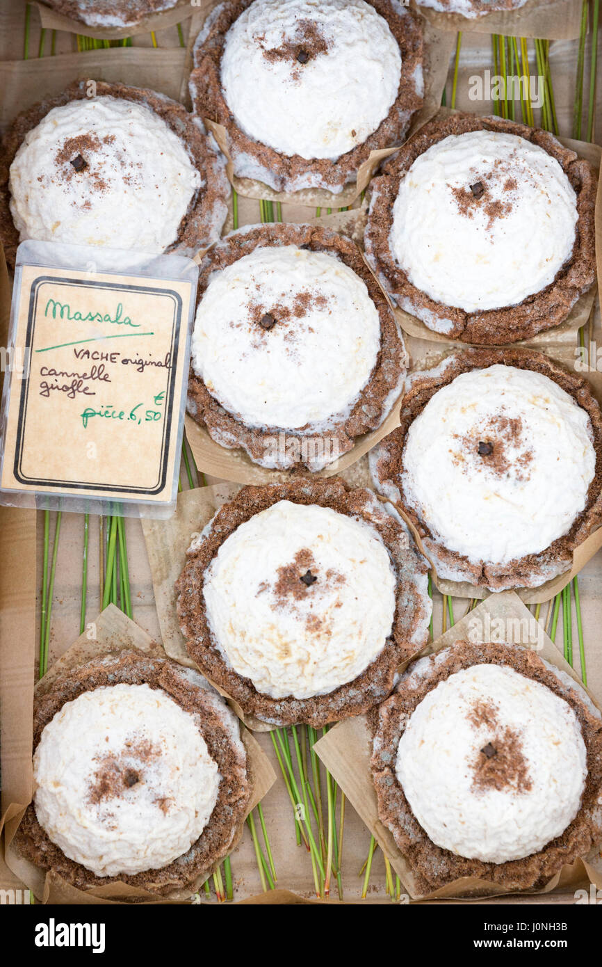 Artisan French cow's milk cheese, Massala, on sale at street market Bordeaux, France - Stock Image