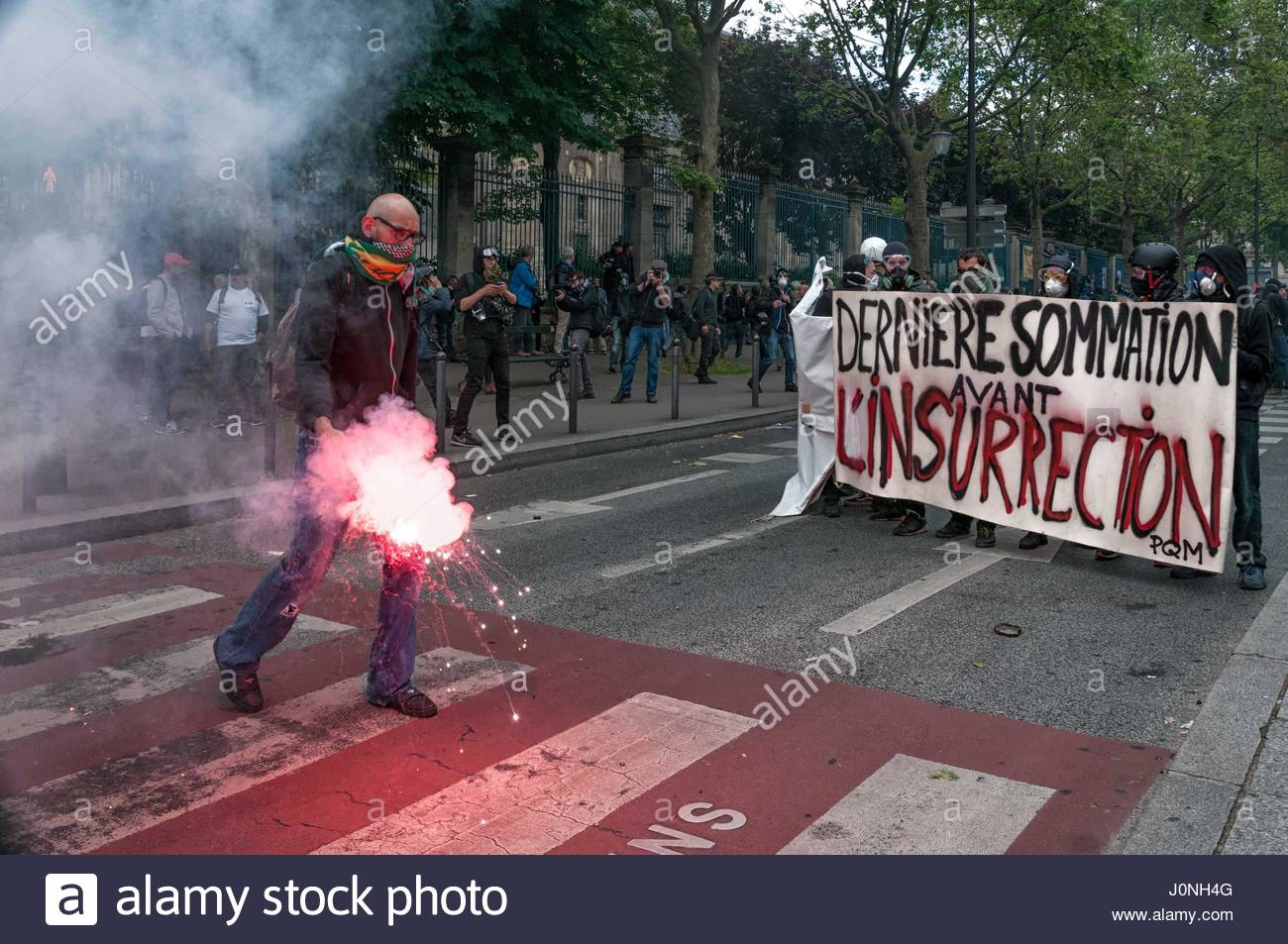 PARIS-DECEMBER 2016 —Demonstrators use tear gas during a protest. Train drivers on strike to reject reform relaxing - Stock Image