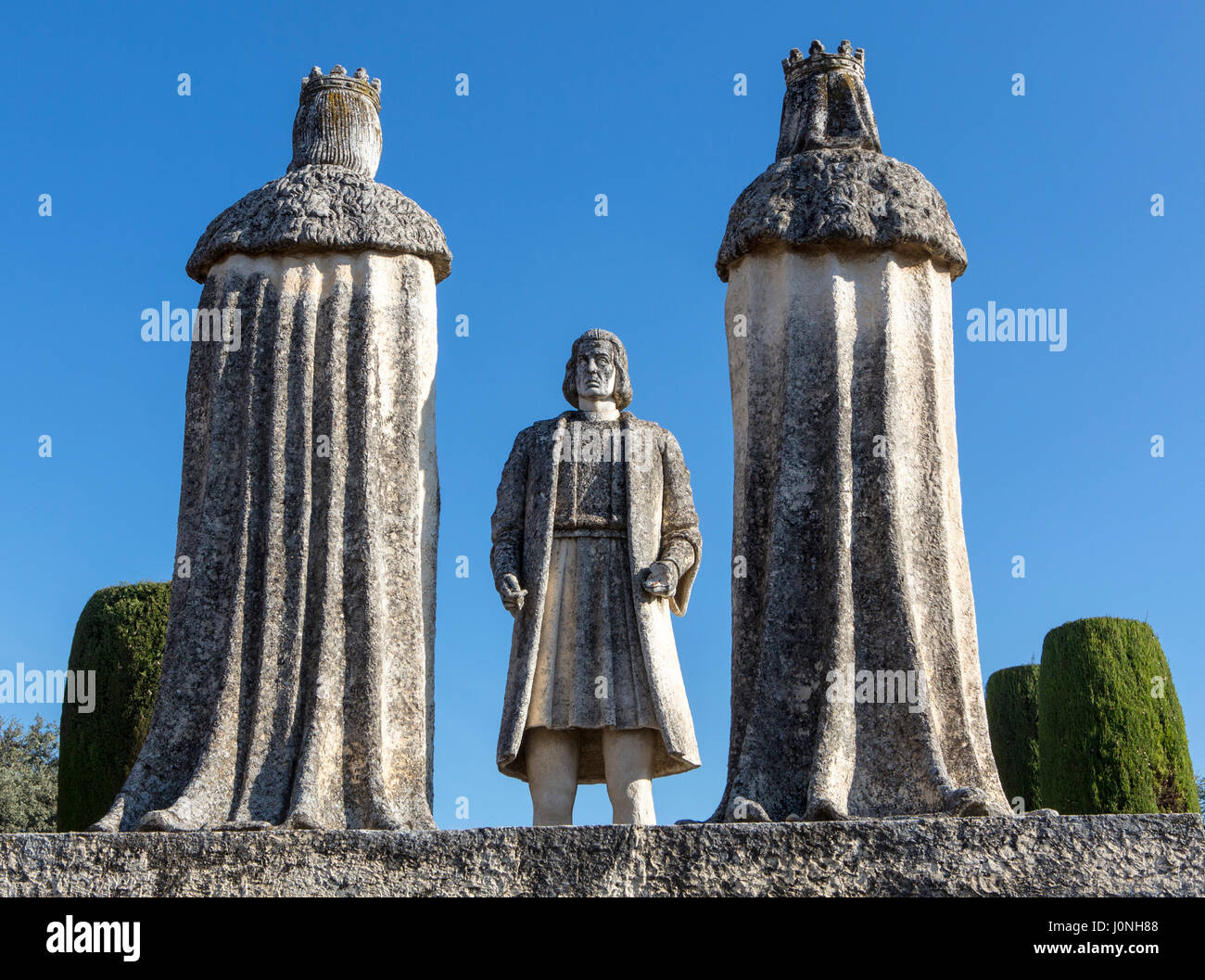 A statue showing Ferdinand and Isabella, rulers of Spain in the 15th century, meeting Christopher Columbus at the - Stock Image