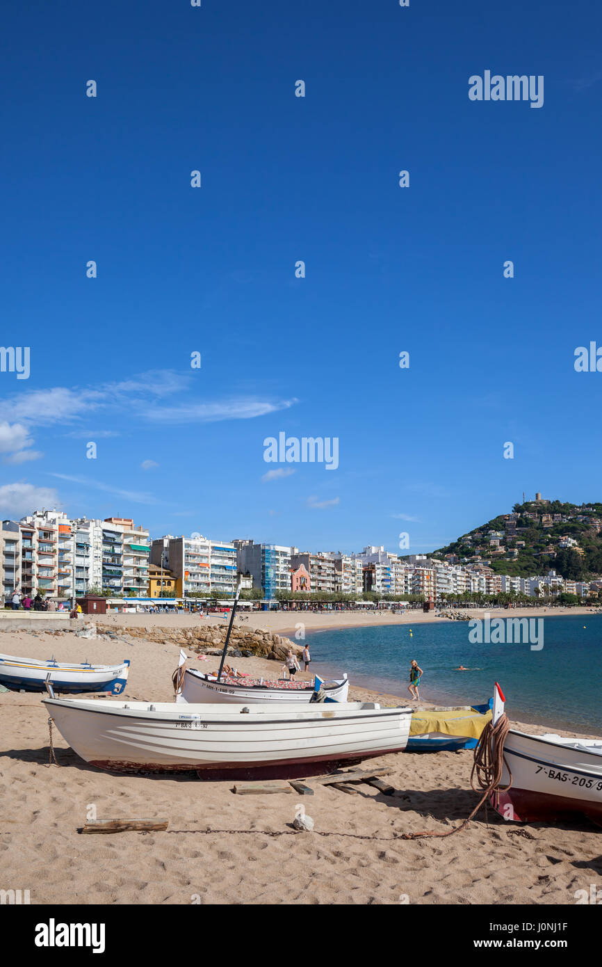 Blanes resort seaside town on Costa Brava in Spain, fishing boats on a beach at Mediterranean Sea and town skyline Stock Photo