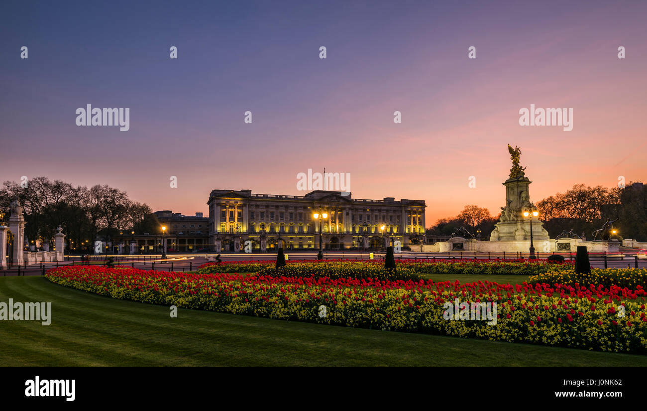 Lights at dusk and red skies over Buckingham Palace, London, UK - Stock Image