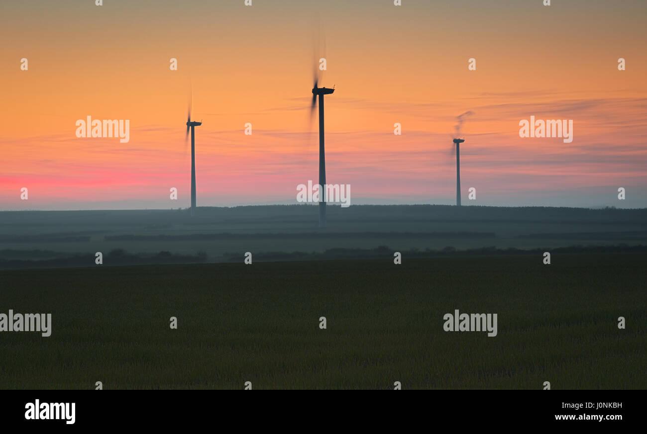 sunset turbines Stock Photo