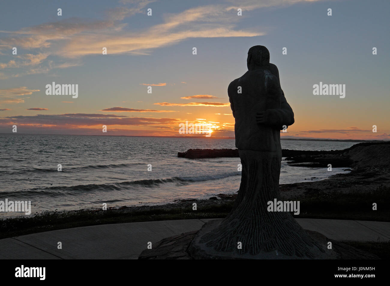 Statue of a grieving couple in the Memorial Garden for those Lost at Sea in Kilmore Quay, Co Wexford, southern Ireland. - Stock Image