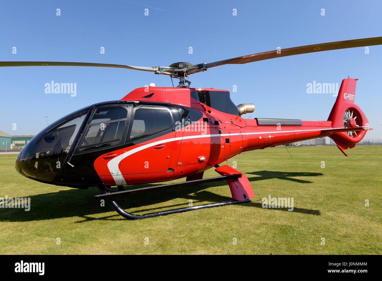 Airbus EC130 G-PERT helicopter at the fiftieth anniversary event of the Gazelle at Middle Wallop, Hampshire, UK.Space - Stock Image