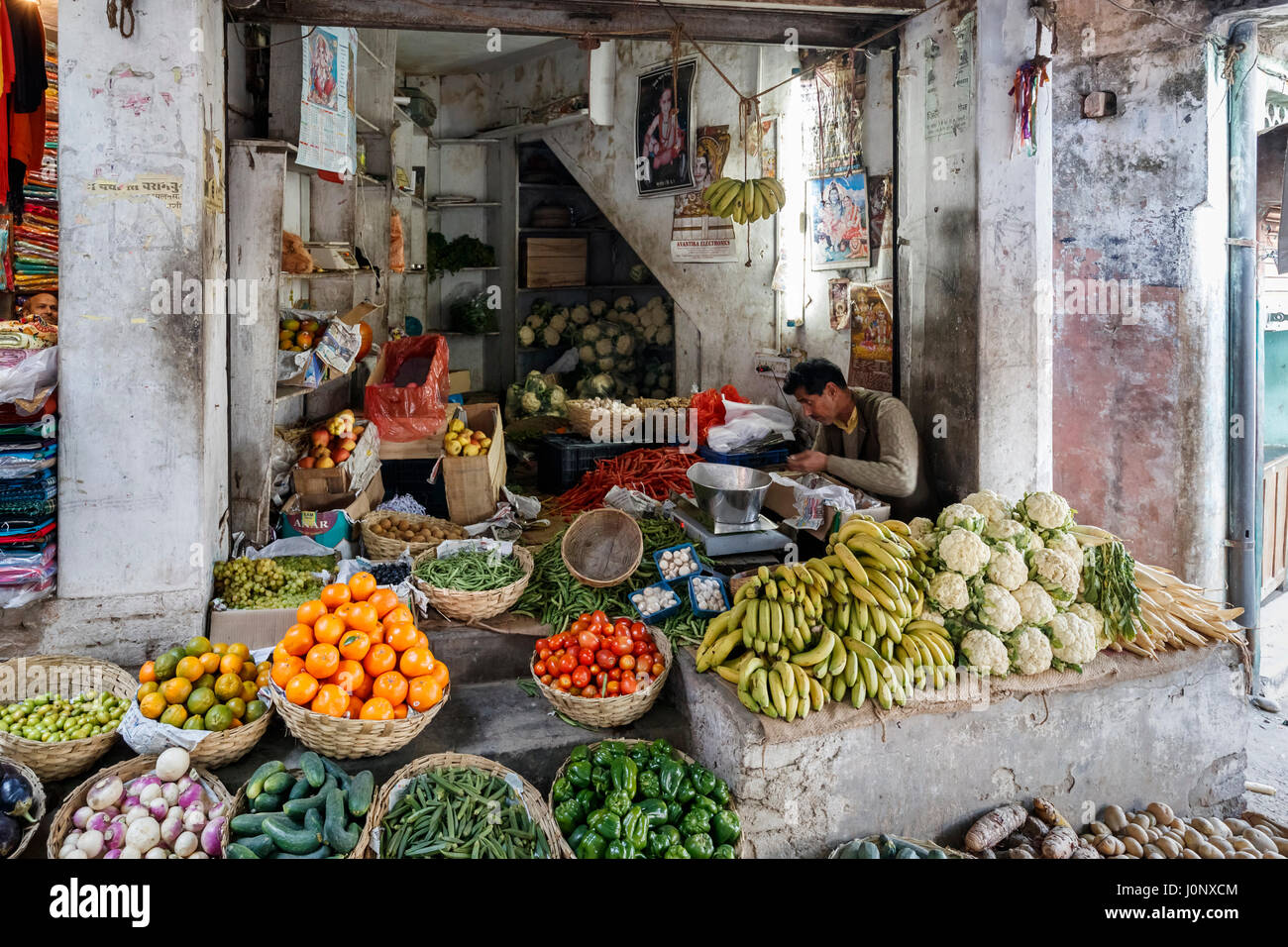 Fruit and vegetables on display outside a greengrocery shop in Pragpur, a heritage village in Kagra district, Himachal - Stock Image
