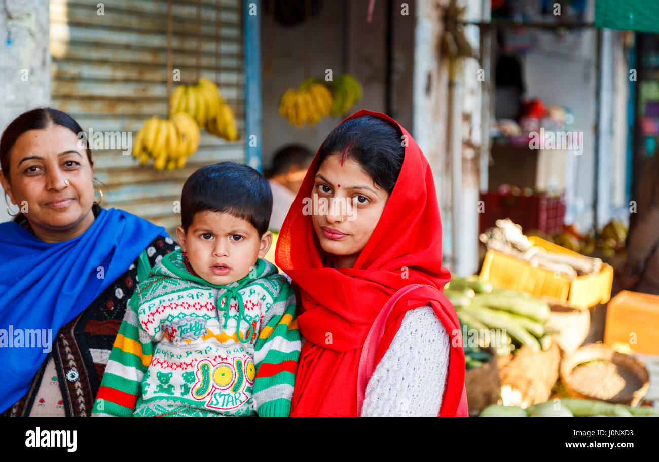 Local people in Pragpur, a heritage village in Kagra district, Himachal Pradesh, India, young Hindu mother with - Stock Image