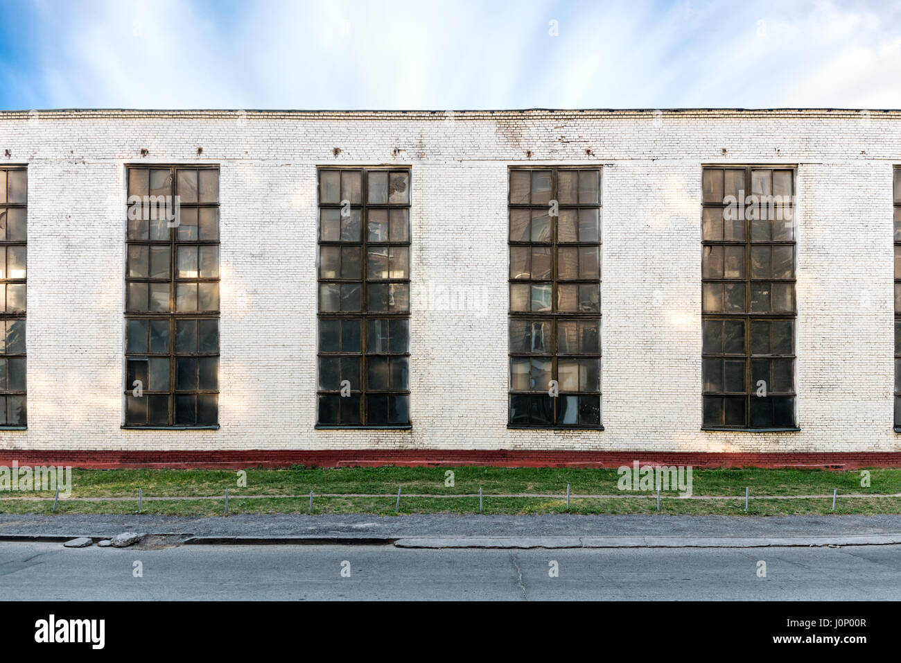 old industrial building facade with large windows stock photoold industrial building facade with large windows