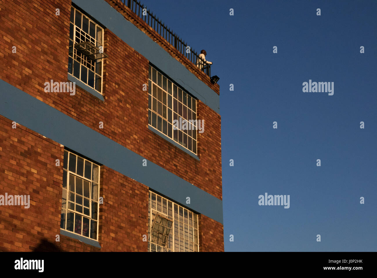 A man looks across the South African city of Johannesburg nearby to the gentrification project of Maboneng - Stock Image