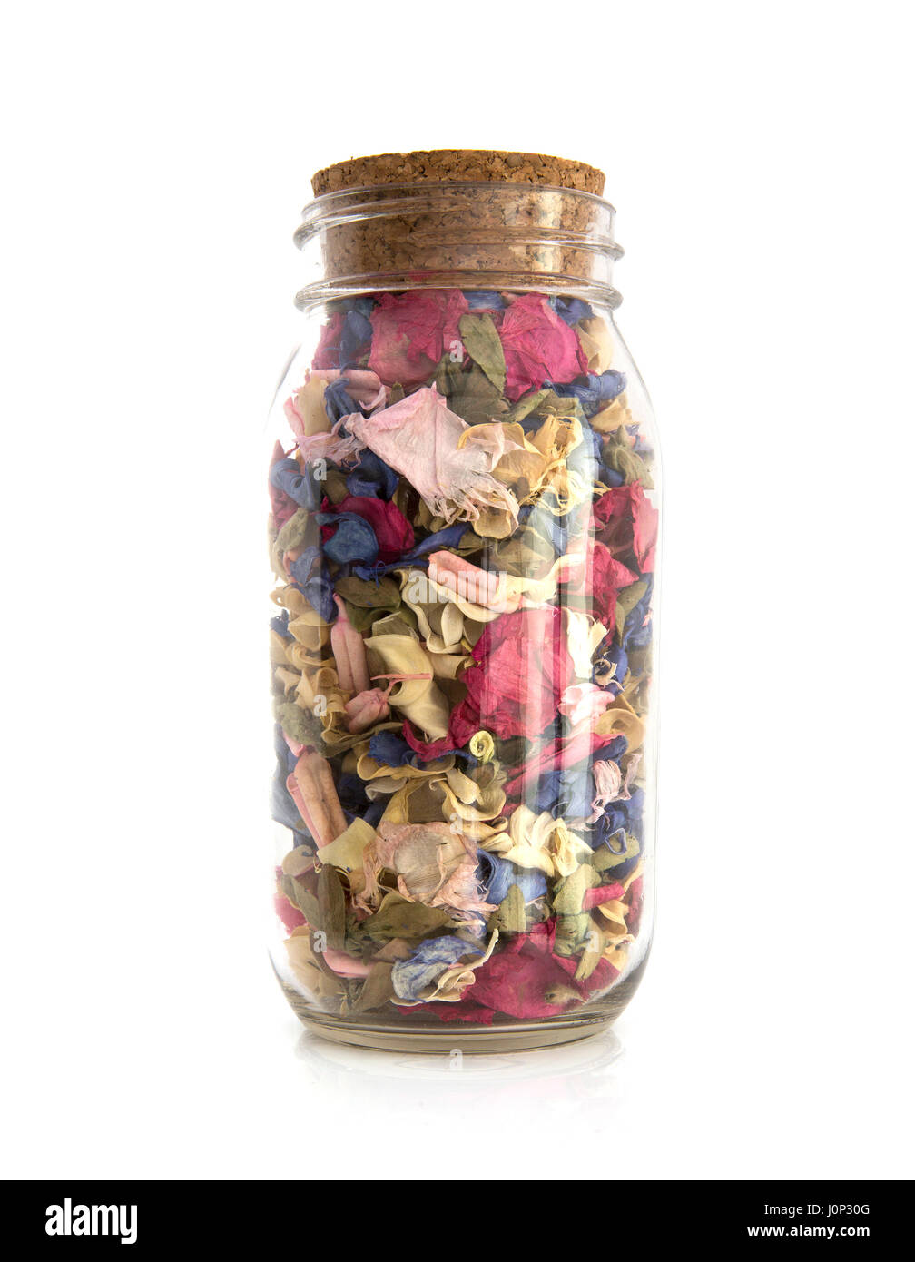 Colourful Potpourri in a jar on a white background - Stock Image
