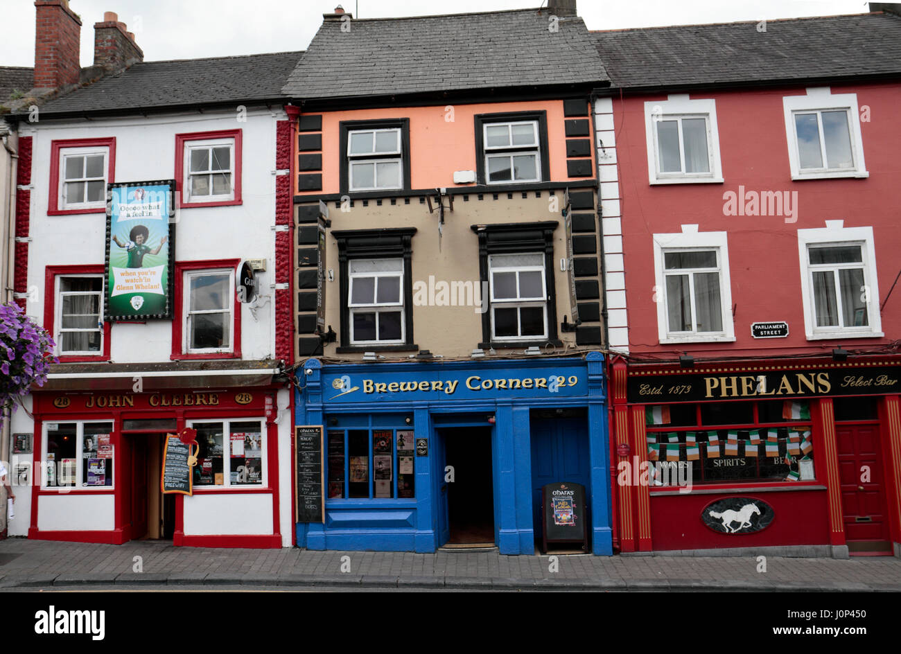 A line of colourful pubs on Brewery Corner, Parliament Street in the city of Kilkenny, County Kilkenny, Ireland, - Stock Image