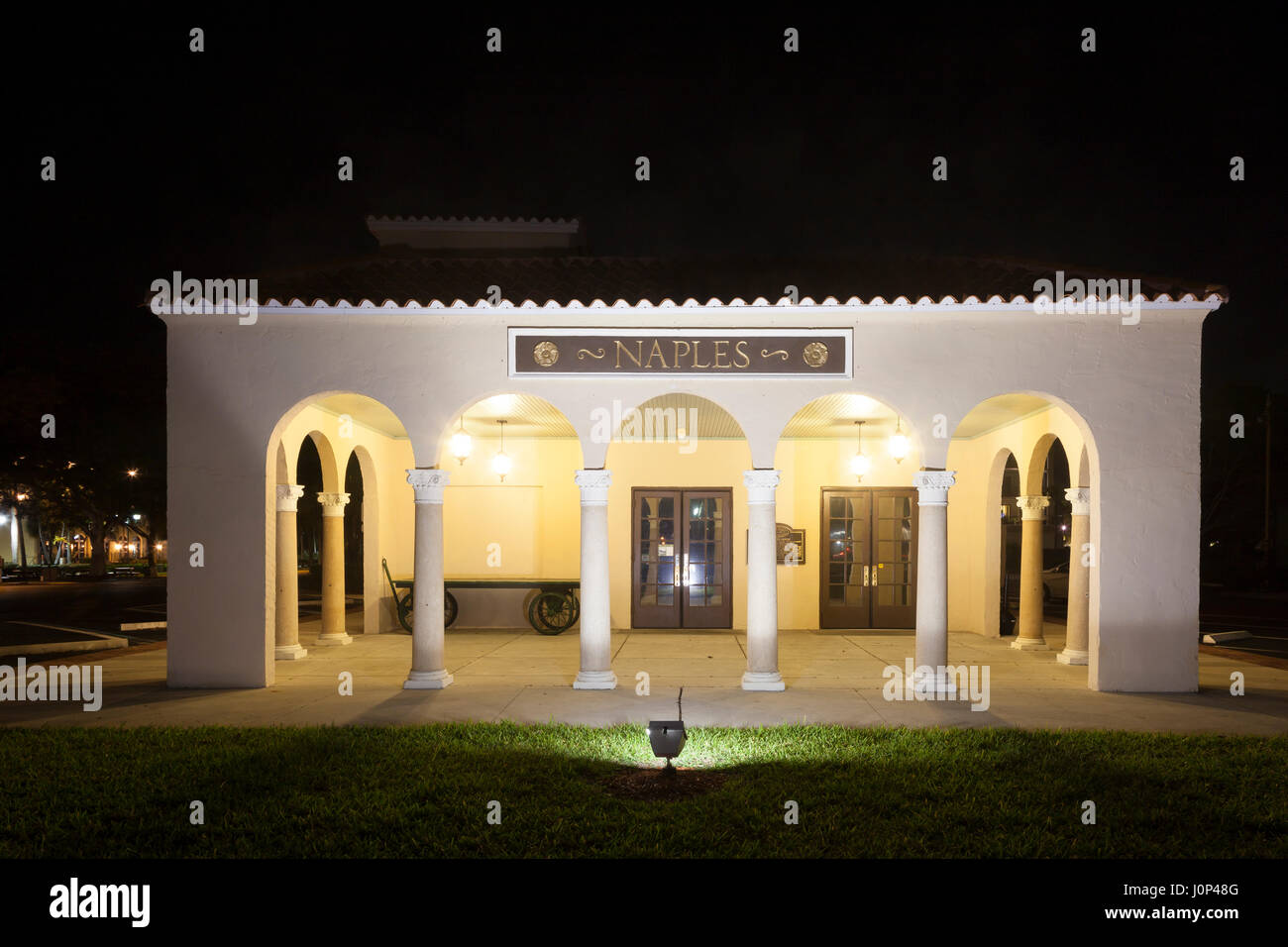 Naples, Fl, USA - March 21, 2017: The Naples depot and train museum illuminated at night. Florida, United States - Stock Image