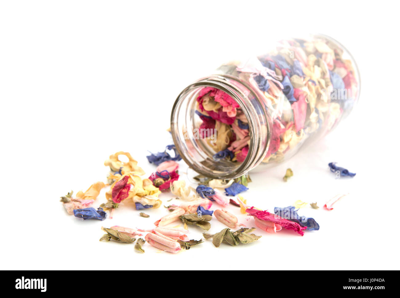 Colourful Potpourri in a jar on a white background with shallow depth of field - Stock Image
