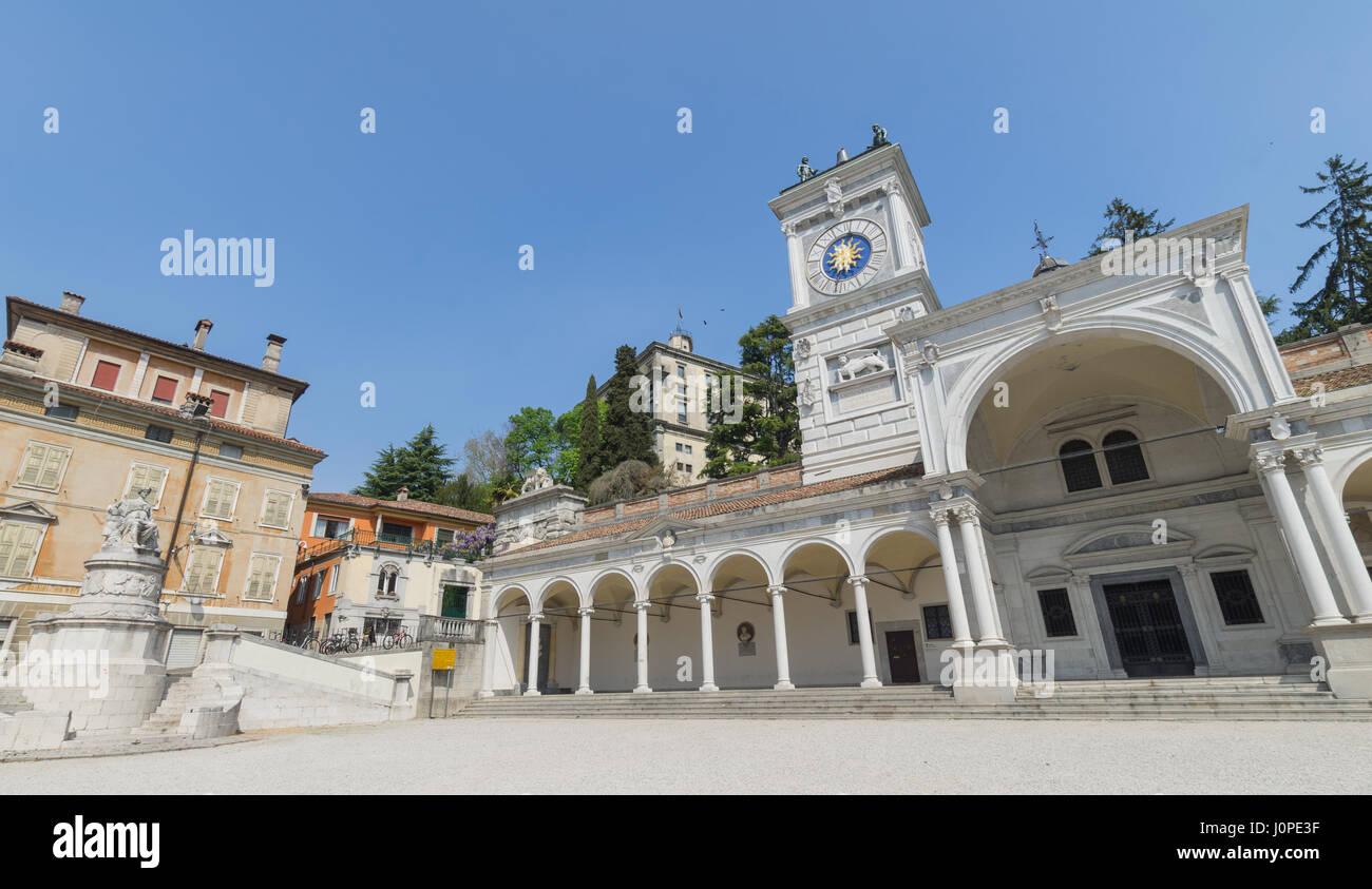 Piazza della libertà (Freedom square) with the arches of the Loggia di San Giovanni and behind the caste of - Stock Image