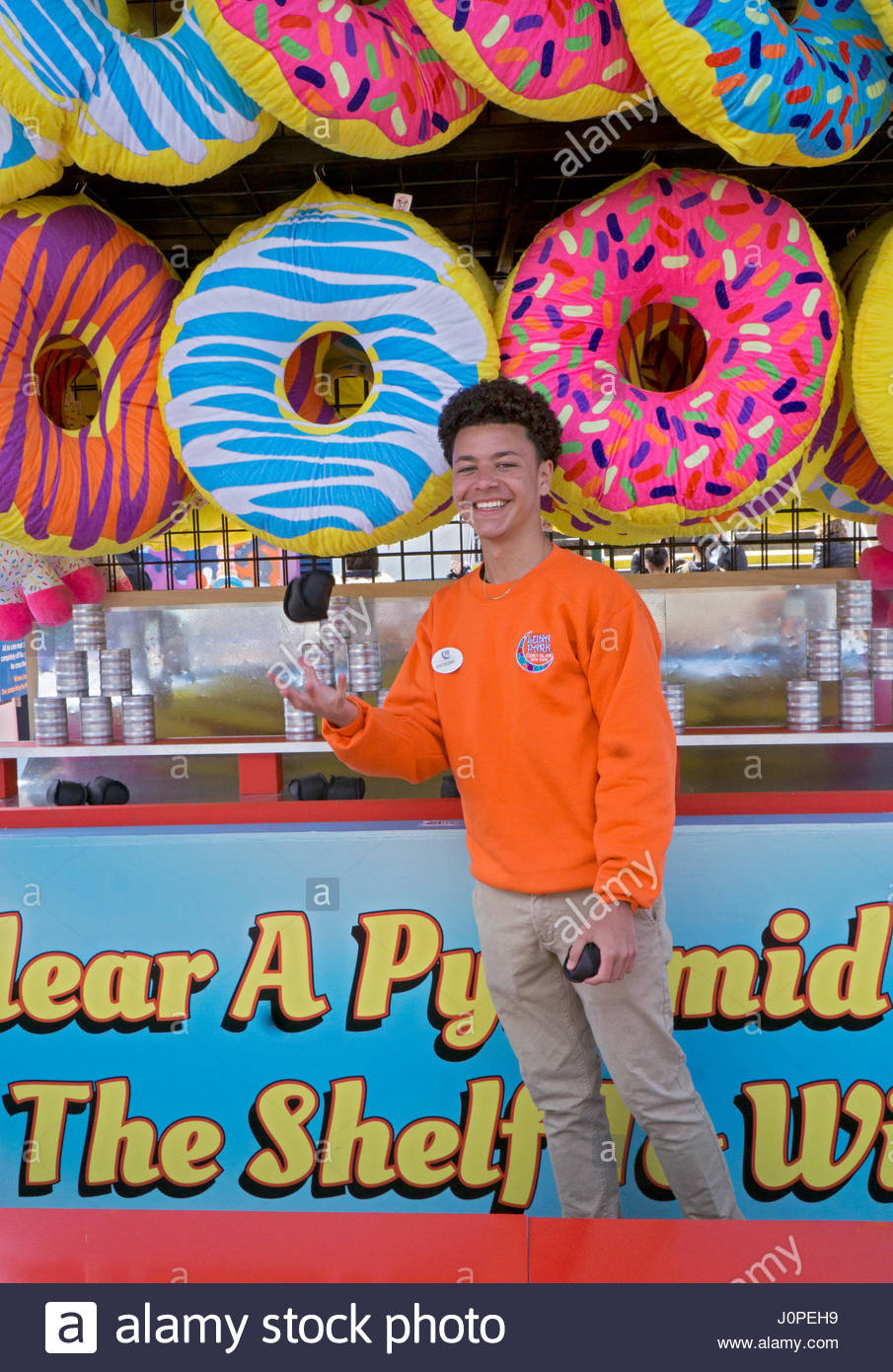 A teenage student with a part time and summer job at Luna Park in Coney Island, Brooklyn, New York City. - Stock Image