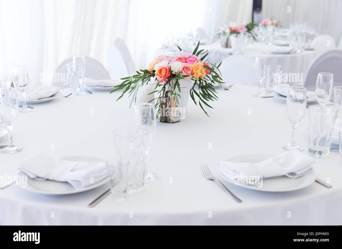 Served White Wedding Table Layout With Flowers Stock Photo