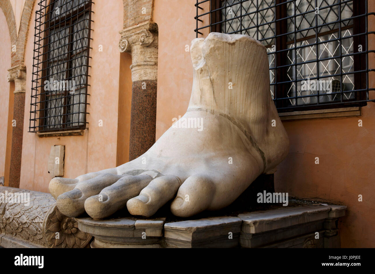 Foot of a gigantic statue of Emperor Constantine in the Palazzo dei Conservatori at the Capitoline Museums, Rome, - Stock Image