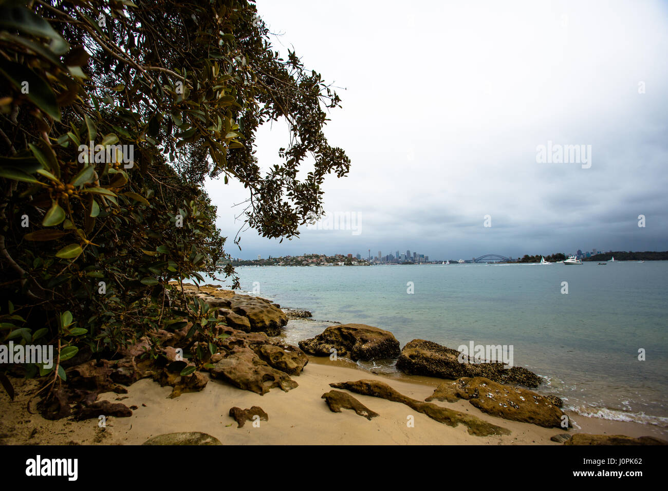 The beach and Sydney Cove from Hermit bay in the eastern suburbs - Stock Image