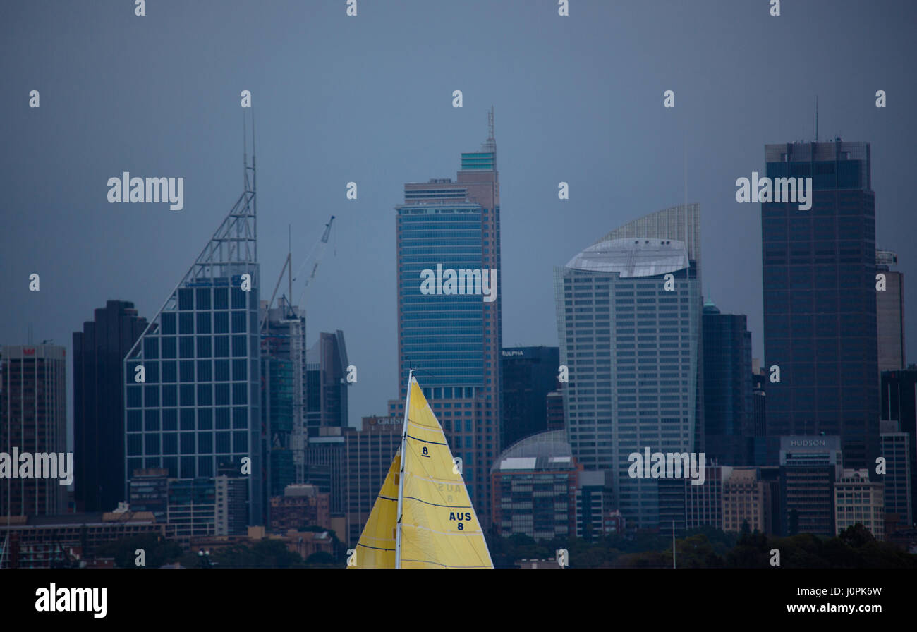 An abstract photo of a sailing passing in front of the Sydney skyline - Stock Image