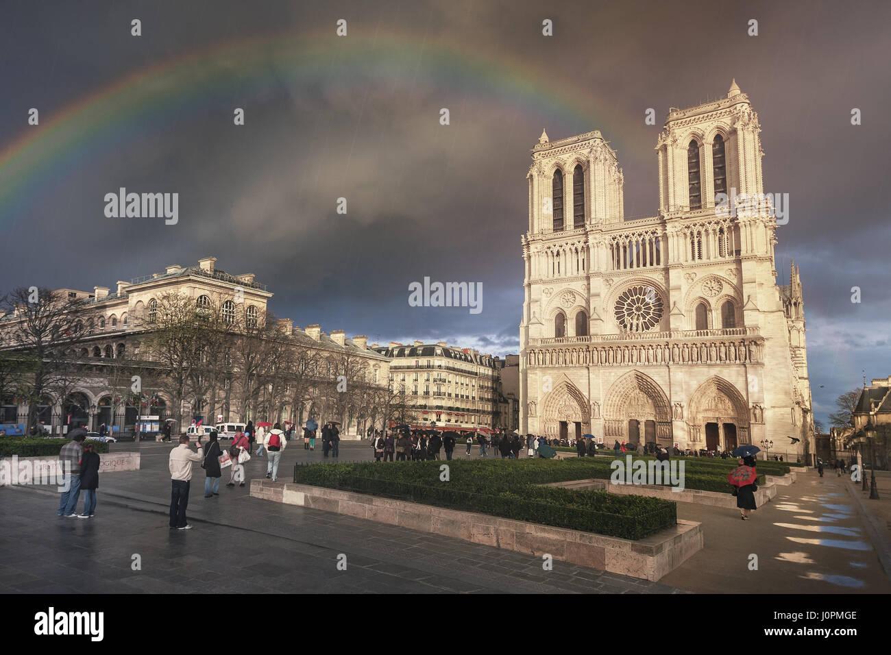 Rain and a rainbow over Cathédrale Notre-Dame de Paris. France Stock Photo