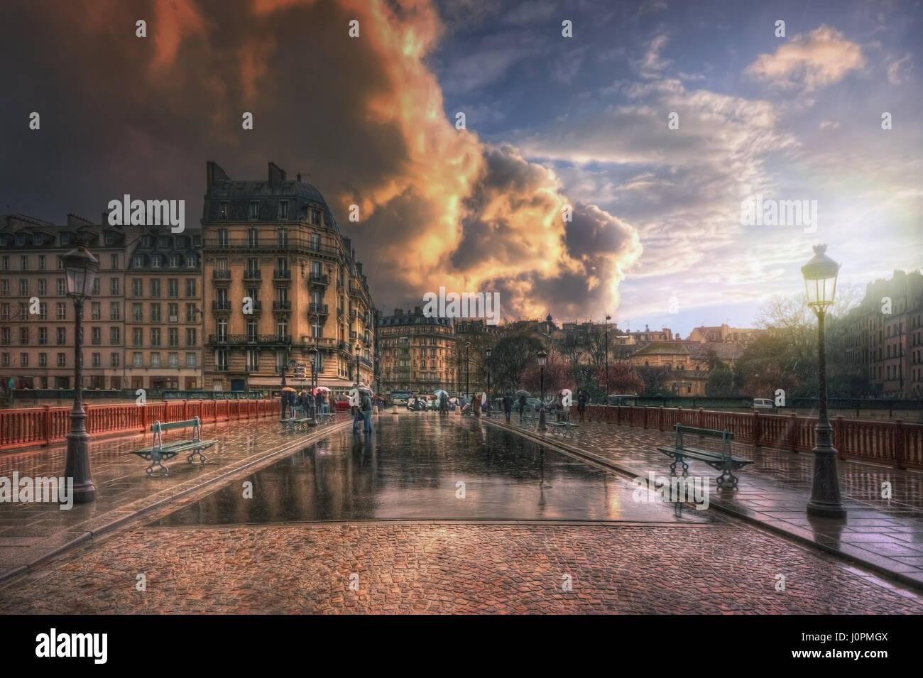 Pont au Double during a rain at sunset. France. Paris - Stock Image