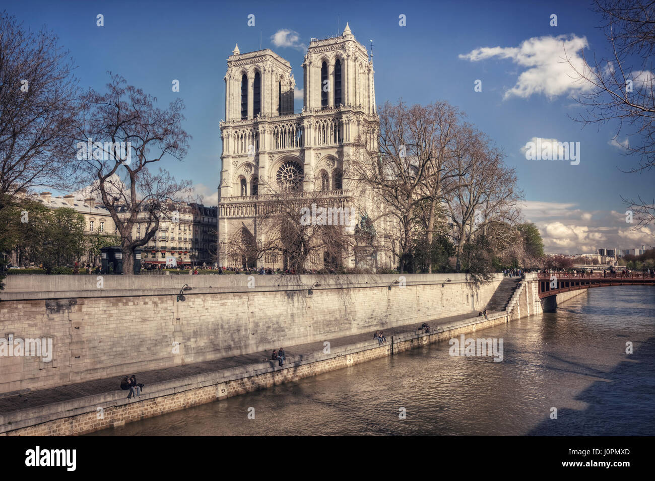 View of the Notre-Dame, Pont au Double and Promenade Maurice Carême on a sunny spring day. Paris. France - Stock Image