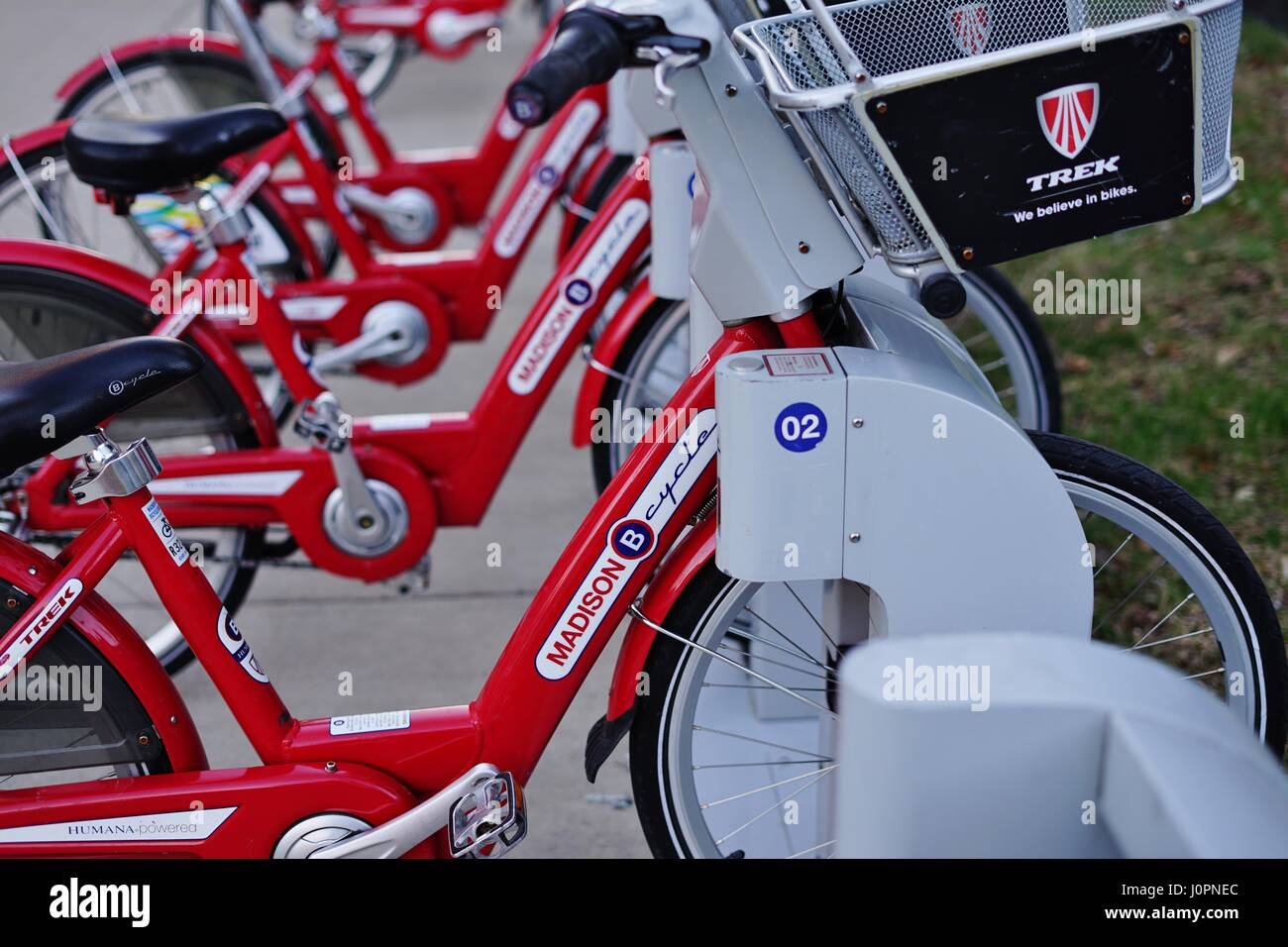 View of red B-Cycles share bicycles lined up in the streets of the Wisconsin capital. - Stock Image