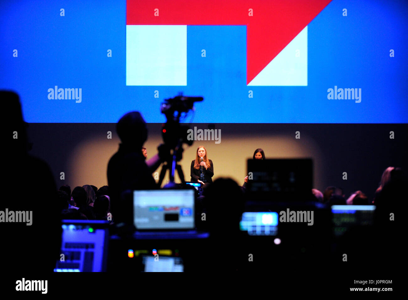Behind the scenes of the audio, light and video production while Chelsea Clinton speaks to a crowd at NeueHouse - Stock Image