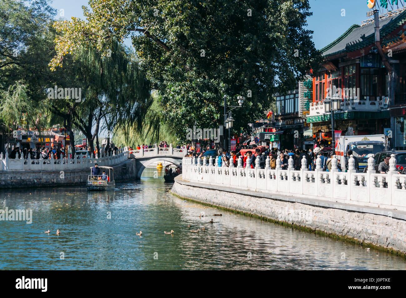 25,October 2014 -In Beijing ShiChaHai. Boats and bridge on Qianhai lake in Shichahai lake of Beijing China, many - Stock Image