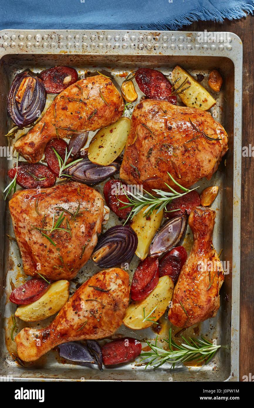Spanish chicken tray bake with chorizo, potatoes and red onion Stock Photo