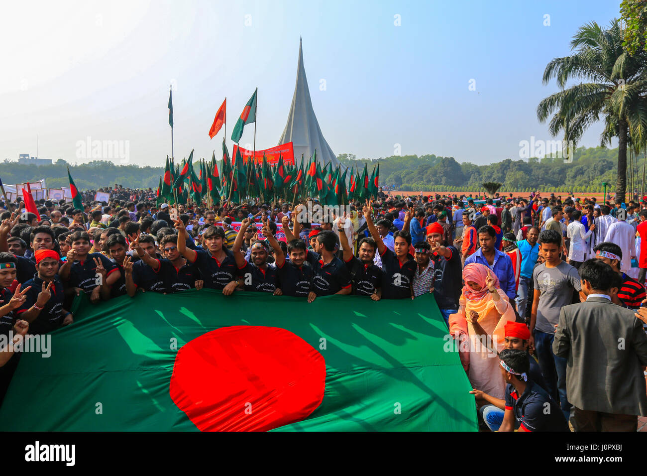People pay tribute at the National Memorial Tower or Jatiya Smriti Shoudha at Savar on Victory Day, about 20 km Stock Photo