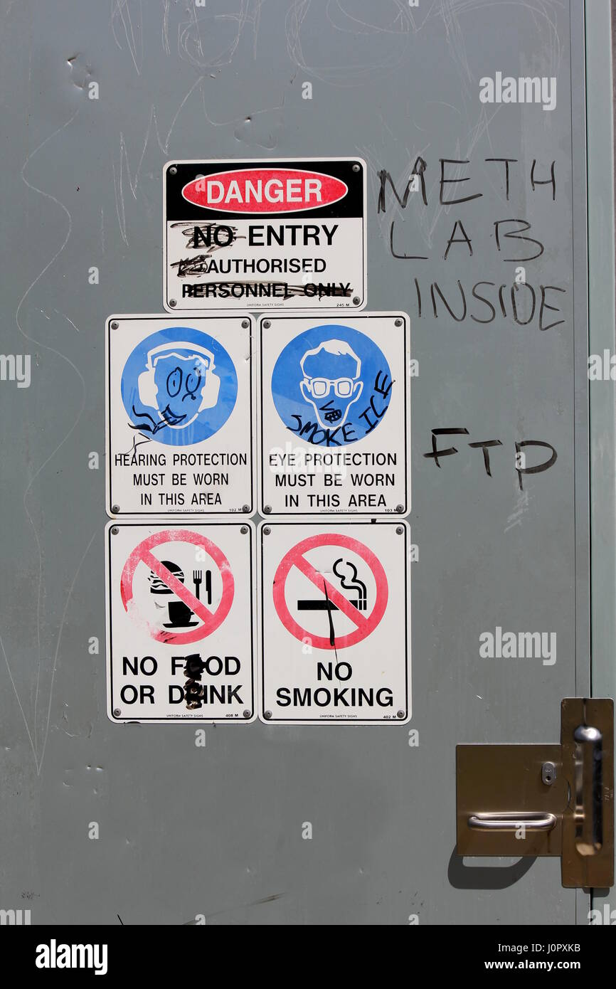 Warning Signs on wall for employees or workers - Stock Image