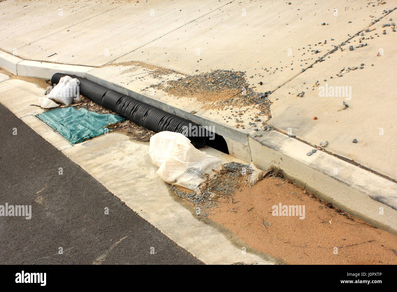 Residential storm waterdrain with barriers for protection during estate construction - Stock Image