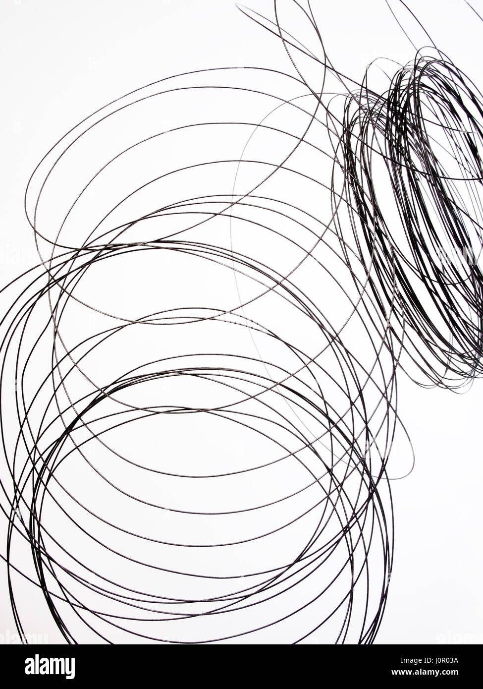 Tangled thin wire. On white background. - Stock Image