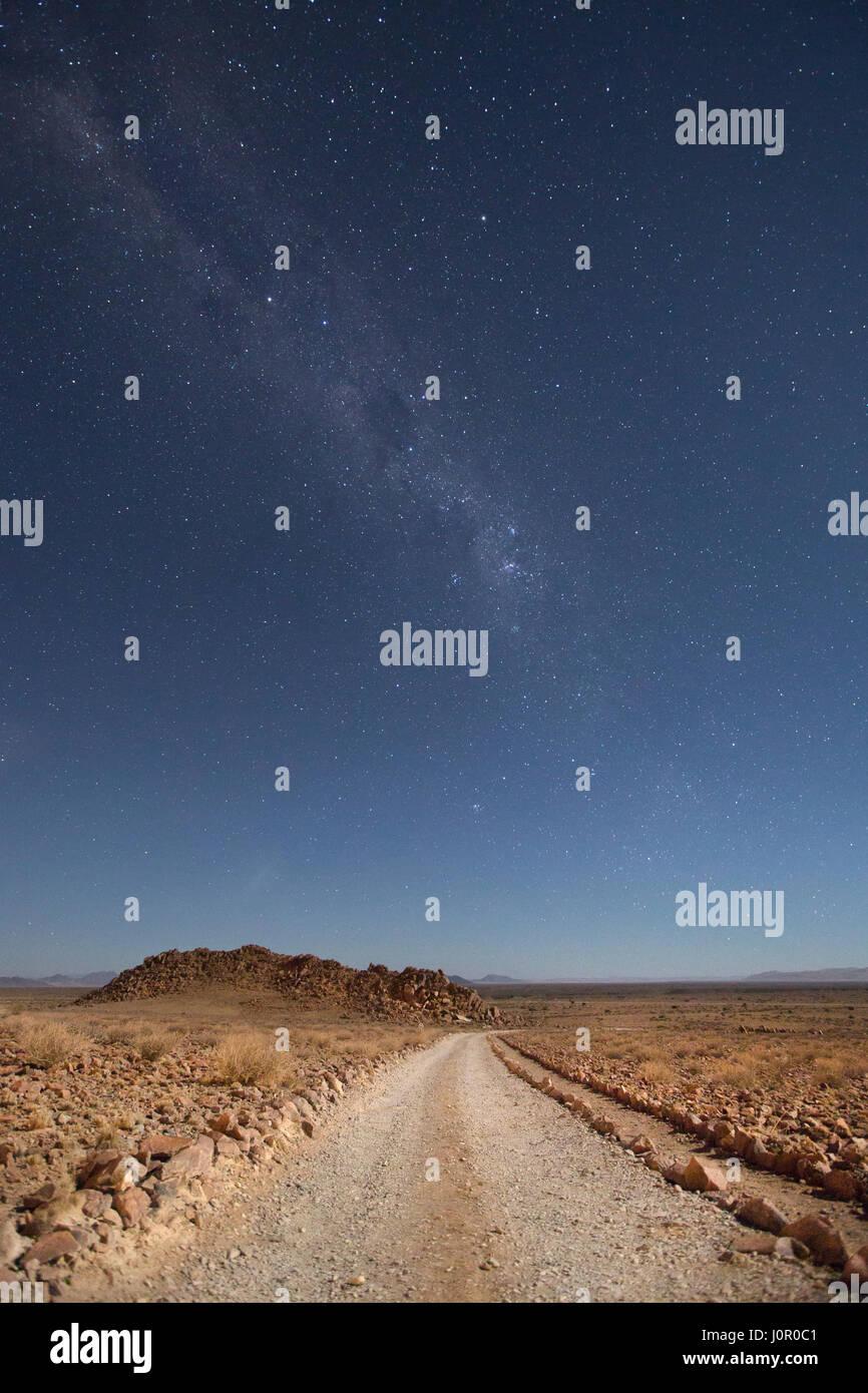 Desert road at night - Stock Image